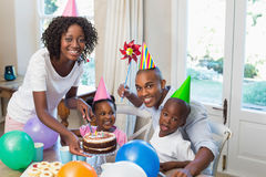 Happy family celebrating a birthday together at table Stock Photography