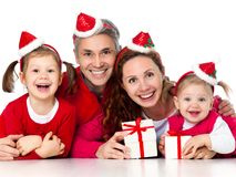 Happy family celebrating Christmas. Portrait of happy family in Christmas hat on white background Stock Photos