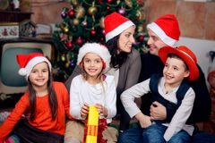 Happy family celebrating Christmas stock photos