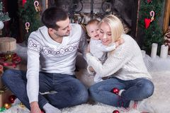 Happy family celebrating Christmas stock images