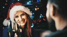 Happy family celebrating Christmas or New Year. Young couple family celebrating Christmas or New Year with glasses of champagne with Xmas tree on background stock video footage