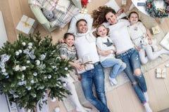 Happy family celebrating Christmas royalty free stock images