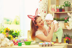 Happy family celebrating easter mother and baby with bunny ears Stock Images