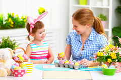 Happy family celebrating Easter. mother and daughter at home Stock Photo