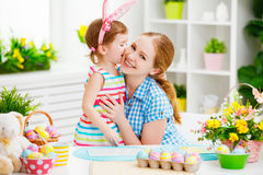 Happy family celebrating Easter. mother and daughter kissing at Royalty Free Stock Image