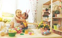 Happy family celebrating Easter. mother and daughter kissing at Royalty Free Stock Photos