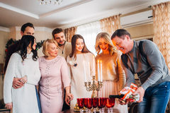 Happy family celebrating. The father pours champagne, family concept Stock Image