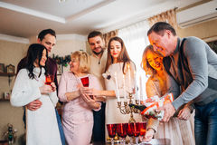 Happy family celebrating. The father pours champagne, family concept Stock Photography