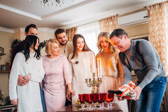 Happy family celebrating. The father pours champagne, family concept Royalty Free Stock Photo
