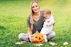 Happy family celebrating Halloween Stock Image