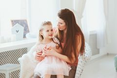 Happy family celebrating mothers day. Casual lifestyle capture of mother and toddler daughter royalty free stock photos