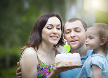 Happy family celebrating second birthday of baby daughter Stock Image