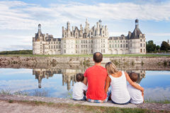 Happy family on Chambord chateaux, enjoying summer holiday Stock Photo