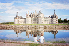 Happy family on Chambord chateaux, enjoying summer holiday Stock Image