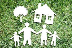 Happy family characters on backdrop of green grass Royalty Free Stock Image