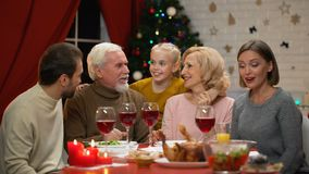 Happy family chatting at Xmas dinner telling funny stories, Xmas miraculous time. Stock footage stock footage
