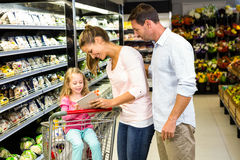 Happy family checking grocery list Royalty Free Stock Images