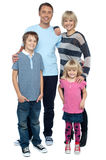 Happy family with cheerful children Stock Photography