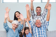 Happy family cheering in the living room royalty free stock photos