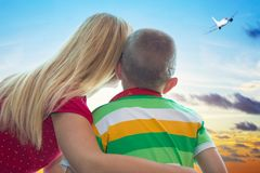 Happy family with child at the airport. Mother and son look out at the airplane. stock photography