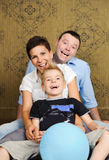 Happy family with child. Beautiful happy family having fun at home Royalty Free Stock Image