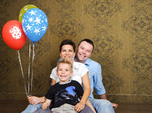Happy family with child. Beautiful happy family having fun at home Stock Photos