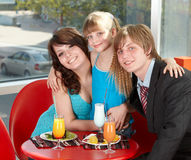 Happy family with child in cafe. Stock Photos