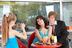 Happy family with child in cafe. Stock Image