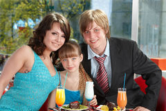 Happy family with child in cafe. Stock Photography