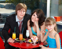 Happy family with child in cafe. Royalty Free Stock Photos
