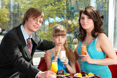 Happy family with child in cafe. Royalty Free Stock Photography