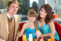 Happy family with child in cafe. Stock Photo