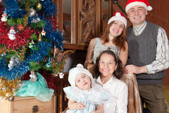 Happy family with child in christmas hats Stock Photo