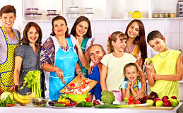 Happy family  with child cooking at kitchen. Royalty Free Stock Photography
