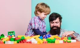 Happy family. Child development and upbringing. Importance of playing together. Dad and son have fun. Childish cheerful. Dad and funny son. Dad play toys with stock image