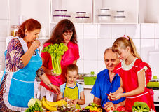Happy family  with child and grandparent cooking Royalty Free Stock Photos