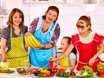 Happy family  with child and grandparent cooking Stock Photo