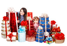 Happy family with child and group gift box. Royalty Free Stock Images