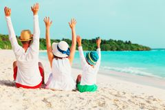 Happy family with child hands up on beach Royalty Free Stock Images