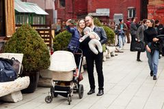 Happy family with a child makes a selfie in the city Park. Mosco Stock Image