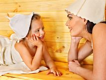 Family with child relaxing at sauna. Stock Photo