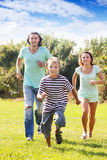 Happy family with  child  running  at  park Royalty Free Stock Images