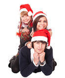 Happy family with child in santa hat. Stock Image