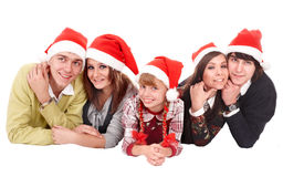 Happy family with child in santa hat. Royalty Free Stock Images