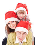 Happy family with child in santa hat. Royalty Free Stock Photo