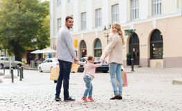 Happy family with child and shopping bags in city Stock Photography