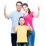Happy family with child shows the thumbs up sign. Stock Photo