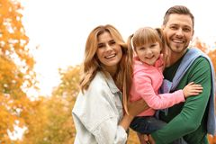 Happy family with child together in park. Autumn walk stock photography