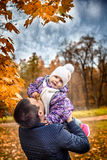 Happy family with the child on walk in the park Royalty Free Stock Photography