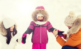Happy family with child in winter clothes outdoors Royalty Free Stock Images